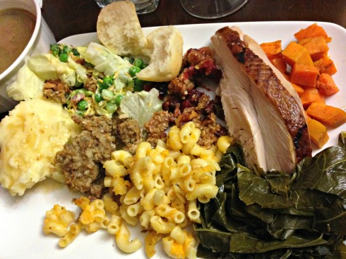 clockwise from left: mashed potatoes and gravy, 7 layer salad, rolls, cranberry sauce, smoked turkey, sweet potatoes, collard greens, mac and cheese, stuffing